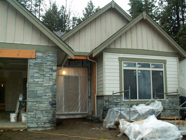 View of rock work in front of house